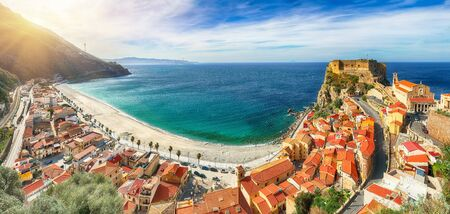 Aerial top view of sandy beach of Tyrrhenian sea bay gulf coast shore of beautiful seaside town village Scilla with green hill and Sicily island background, Calabria, Southern Italy