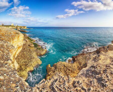 Beach Torre SantAndrea and islet Scoglio the Tafaluro, Otranto region, Salento Adriatic sea coast, Puglia, Italy 스톡 콘텐츠