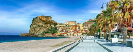 Beautiful seaside town village Scilla with old medieval castle on rock Castello Ruffo, colorful traditional typical italian houses on Mediterranean Tyrrhenian sea coast shore, Calabria, Southern Italy