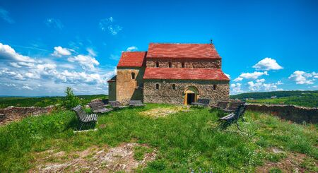 Fantastic summer view of Fortified Lutheran Church St. Michael on top of rock hill in Cisnadioara near Sibiu, Romania, Europe
