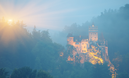 Misty morning view of Bran Castle known for the myth of Dracula. Bran or Dracula Castle in Transylvania, Romania.