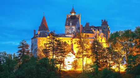 Landscape with medieval Bran castle known for the myth of Dracula at sunset, Brasov landmark, Transylvania, Romania, Europe