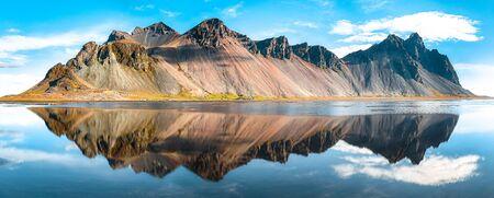 Splendid sunny day gorgeous reflection of Vestrahorn mountaine on Stokksnes cape in Iceland. Location: Stokksnes cape, Iceland, Europe.