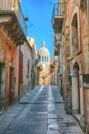 Walking around the old streets of  baroque town Ragusa Ibla. Historic center called Ibla builded in late Baroque Style. Ragusa, Sicily, Italy, Europe. Banco de Imagens