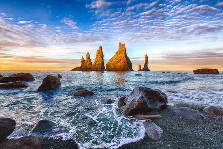 Incredible view of rock formations Troll Toes on Black beach Reynisfjara near the village of Vik.Location: Reynisfjara Beach, Vik Village, Iceland (Sudurland), Europe