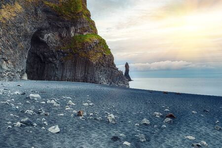 Amazing landscape with basalt rock formations Troll Toes on Black beach Reynisfjara near the village of Vik.