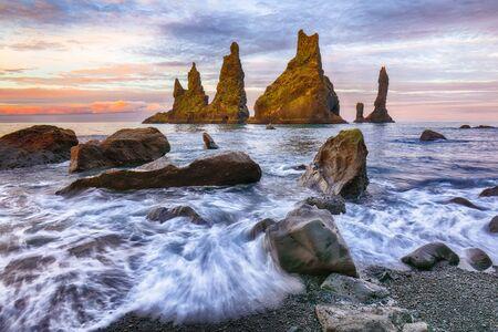Amazing landscape with basalt rock formations Troll Toes on Black beach Reynisfjara near the village of Vik. Location: Reynisfjara Beach, Vik Village, Iceland (Sudurland), Europe