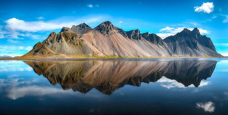Splendid sunny day  gorgeous reflection of Vestrahorn mountaine on Stokksnes cape in Iceland. Location: Stokksnes cape, Vestrahorn , Iceland, Europe.