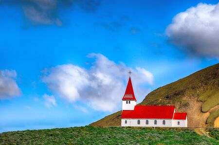 Gorgeous view of Vikurkirkja christian church in front of mouintaine. Scenic image of most popular tourist destination. Location: Vik village in Myrdal Valley, Iceland, Europe.