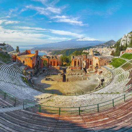 Ruins of ancient Greek theater in Taormina and Etna volcano in the background. Coast of Giardini-Naxos bay, Sicily, Italy, Europe. Imagens