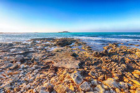 Colorful spring seascape on the Passero cape Sicily. Dramatic morning and gorgeous scene. Island Sicilia, cape Passero, Italy, Europe, Mediterranean sea.
