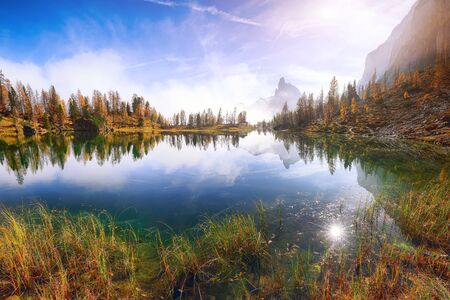 Dramatic foggy autumn landscape. View on Federa Lake early in the morning at autumn. Location: Federa lake with Dolomites peak, Cortina DAmpezzo, South Tyrol, Dolomites, Italy, Europe Reklamní fotografie