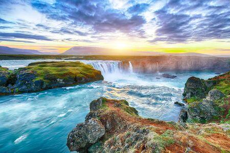 Fantastic sunset scene of powerful Godafoss waterfall. Dramatic sky over Godafoss. Location: Bardardalur valley, Skjalfandafljot river, Iceland, Europe Banco de Imagens - 130806412