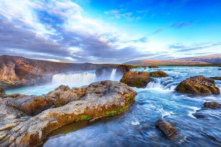 Breathtaking sunset landscape scene of powerful Godafoss waterfall. Dramatic sky over Godafoss. Location: Bardardalur valley, Skjalfandafljot river, Iceland, Europe Foto de archivo - 130806420