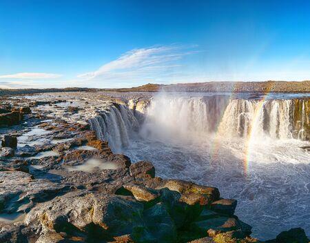 Splendid view of fantastic waterfall and cascades of Selfoss waterfall. Location: Vatnajokull National Park,  river Jokulsa a Fjollum, Northeast Iceland, Europe Banco de Imagens - 130806596