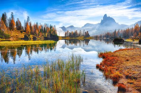 Fantastic autumn landscape. View on Federa Lake early in the morning at autumn. Location: Federa lake with Dolomites peak, Cortina DAmpezzo, South Tyrol, Dolomites, Italy, Europe Reklamní fotografie