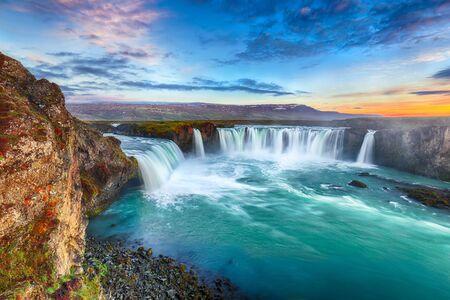Fantastic sunset scene of powerful Godafoss waterfall. Dramatic sky over Godafoss. Location: Bardardalur valley, Skjalfandafljot river, Iceland, Europe Stok Fotoğraf