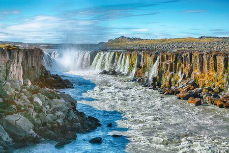 Splendid view of fantastic waterfall and cascades of Selfoss waterfall. Location: Vatnajokull National Park,  river Jokulsa a Fjollum, Northeast Iceland, Europe
