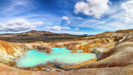 Exotic landscape of Acid hot lake with turquoise water in the geothermal valley Leirhnjukur. Location: valley Leirhnjukur, Myvatn region, North part of Iceland, Europe Banco de Imagens - 130807044