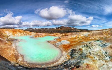 Exotic landscape of Acid hot lake with turquoise water in the geothermal valley Leirhnjukur. Location: valley Leirhnjukur, Myvatn region, North part of Iceland, Europe Banco de Imagens - 130807299