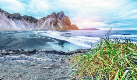 Dramatic black sand beach on Stokksnes cape in Iceland. Location: Stokksnes cape, Vestrahorn Iceland, Europe.