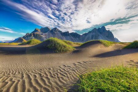 Fantastic sunny day and gorgeous black sand dunes on Stokksnes cape in Iceland. Location: Stokksnes cape, Vestrahorn Iceland, Europe.