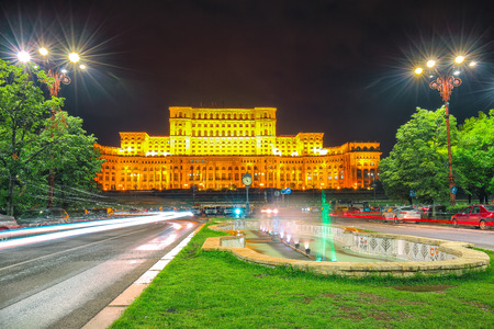 Illuminated Palace of the Parliament of  Bucharest at night. Dramatic evening view of Palace of the Parliament Bucharest city, Romania, Europe Redactioneel