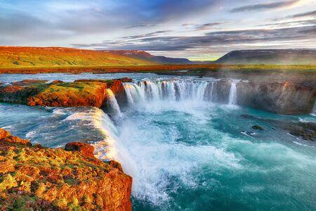 Fantastic sunrise scene of powerful Godafoss waterfall. Dramatic sky over Godafoss. Location: Bardardalur valley, Skjalfandafljot river, Iceland, Europe