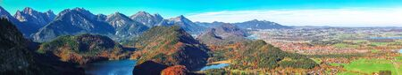 Top view panorama of Alpsee and Schwangau village in autumn. 