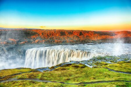 Marvelous sunrise view of the most powerful waterfall in Europe called Dettifoss. Location: Vatnajokull National Park, river Jokulsa a Fjollum, Northeast Iceland, Europe