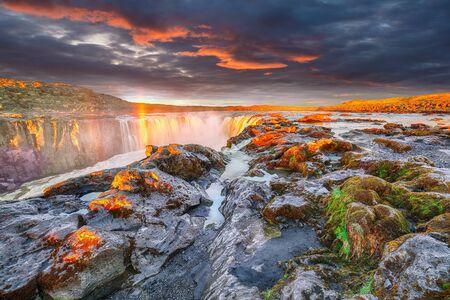 Dramatic sunset view of fantastic waterfall and cascades of Selfoss waterfall. Location: Vatnajokull National Park, river Jokulsa a Fjollum, Northeast Iceland, Europe Stock fotó