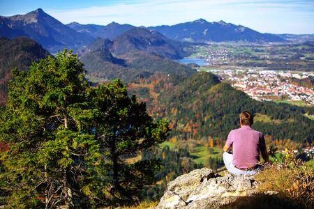 Top view panorama of Alpsee and Schwangau village in autumn. Location: village of Schwangau, near Füssen, southwest Bavaria, Germany, Europe