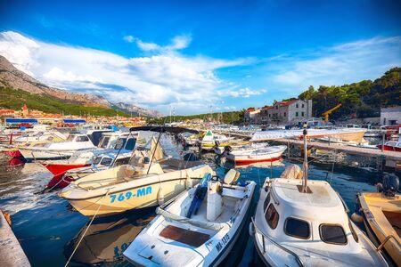 Famous Adriatic resort Makarska with picturesque harbor and touristic boats. Location: Makarska riviera, Dalmatia, Croatia, Europe Stock Photo