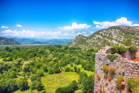 Aerial sunny morning view of valley of Moraca river from Zabljak Crnojevica Fortress. Location:  Skadar Lake National Park, Montenegro, Balkans, Europe.