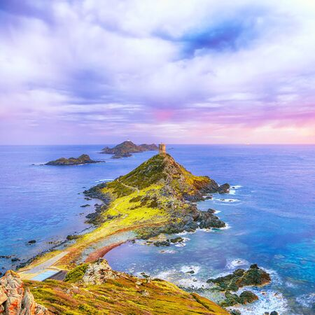 Sunset over popular tourist destination Torra di a Parata with Genoese Tower and Archipelago of Sanguinaires islands at background. Location: Corse-du-Sud, Ajaccio commune, Corsica, France, Europe