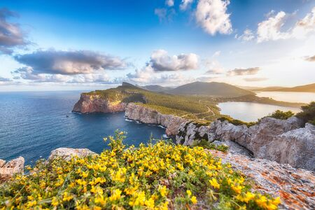 Stunning morning view on Cacccia cape. Panoramic view on the cliffs at sunrise. Fantastic Mediterranean seascape. Location: Alghero, Province of Sassari, Italy, Europe