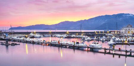 Fantastic sunset view of Boats in Beautiful Marina of Villasimius. Location: Villasimius, Province of Cagliari, Sardinia, Italy, Europe