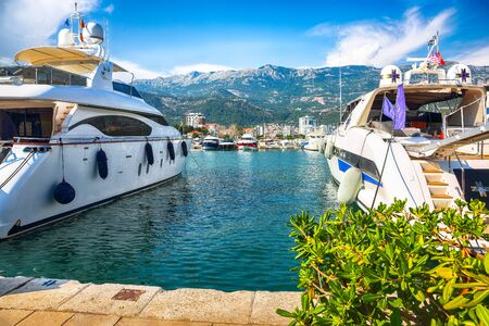 View of waterfront with boats and yachts moored up in town Budva city. Location: Budva, Montenegro, Balkans, Europe