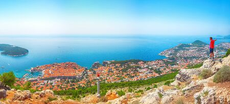 Aerial panoramic view of the old town of Dubrovnik with famous Cable Car on Srd mountain on a sunny day. Location: Dubrovnik, Dalmatia, Croatia, Europe