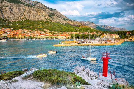 Splendid View of the resort town of Makarska on a summer day with picturesque harbor. Location: Makarska riviera, Dalmatia, Croatia, Europe