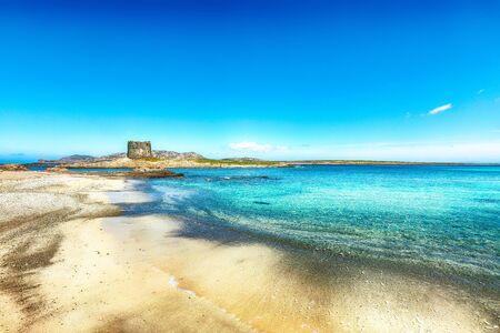 Stunning morning view of Famous La Pelosa beach with Torre della Pelosa. Location: Stintino, Province of Sassari, Italy, Europe Stock Photo