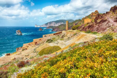 Splendid spring view of ancient ruins of Laveria Lamarmora (Miniera di Nebida). Stunning Mediterranean seascape. Location: Nebida, Sardinia, Italy Europe