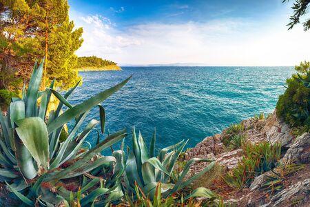 Beautiful sunset above Adriatic sea and coastline in Makarska. Location: Makarska riviera, Dalmatia, Croatia, Europe Imagens