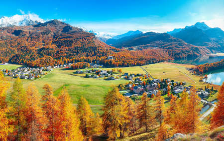 Astonishing autumn scene over Sils im Engadin (Segl) village and Sils lake(Silsersee). Location: Sils im Engadin, Maloya district, Engadine region, Grisons canton, Switzerland, Europe.