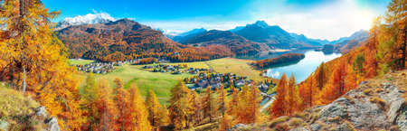 Astonishing autumn panorama over Sils im Engadin (Segl) village and Sils lake(Silsersee). Location: Sils im Engadin, Maloya district, Engadine region, Grisons canton, Switzerland, Europe. Stock Photo