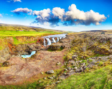 Captivating view of  Kolufossar waterfall at summer sunny day.  Popular tourist travel destination in Iceland . Location: Kolufossar waterfall, Vestur-Hunavatnssysla, Iceland, Europe