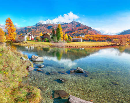 Spectacular autumn scene of Sils im Engadin (Segl) village and  Sils Lake (Silsersee).  Location: Sils im Engadin, Maloya district, Engadine region, Grisons canton, Switzerland, Europe.