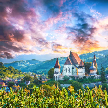 Beautiful medieval architecture of Biertan fortified Saxon church in Romania protected by Unesco World Heritage Site. Amazing sunset in Biertan.Transylvania, Sibiu, Biertan, Romania, Europe. Editorial