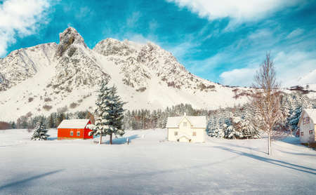 Astonishing winter scenery with traditional Norwegian wooden houses and pine trees near Valberg village at Lofotens. Location: Valberg, Lofotens, Norway, Europe.