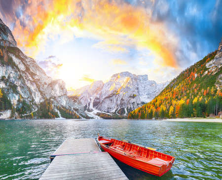 Marvelous scenery of famous alpine lake Braies at autumn during sunrise. Location: national park Fanes-Sennes-Braies, region Trentino-Alto Adige, province Bolzano, Italy, Europe Banco de Imagens